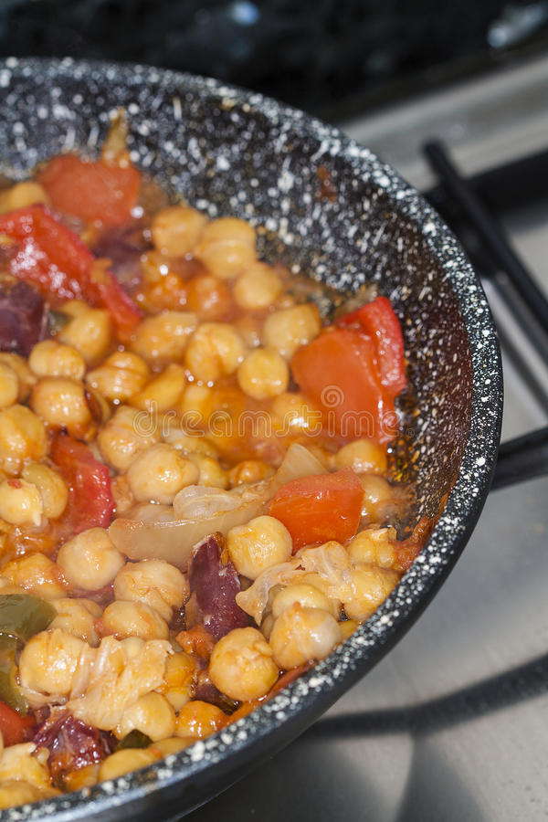Garbanzos y Chorizo. Chickpeas and spicy sausage with red stock images