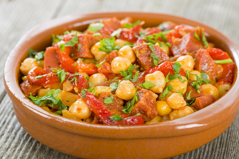 Garbanzos y Chorizo. Chickpeas and spicy sausage with red peppers tapas. Traditional Spanish dish stock photo