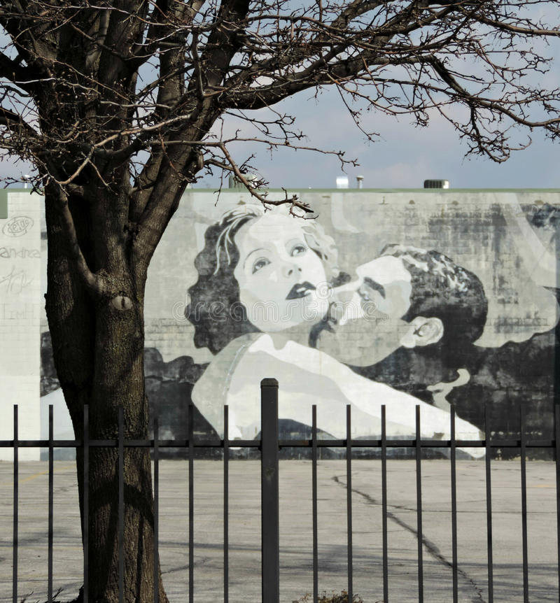 Garbo and Gilbert Love Scene Street Art in Downtown Columbus Ohio. Garbo & Gilbert, a wall mural in the discovery district in downtown Columbus, depicts a love royalty free stock photo