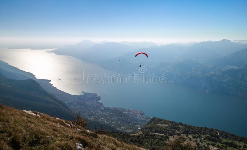 Garda lake and Monte Baldo. View on Garda lake and paragliders from the mountain Monte Baldo, Malcesine, Lombardy, Italy royalty free stock photography