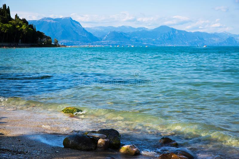 Garda lake, Sirmione, Italy. Beautiful view to the lake and mountains. royalty free stock photo