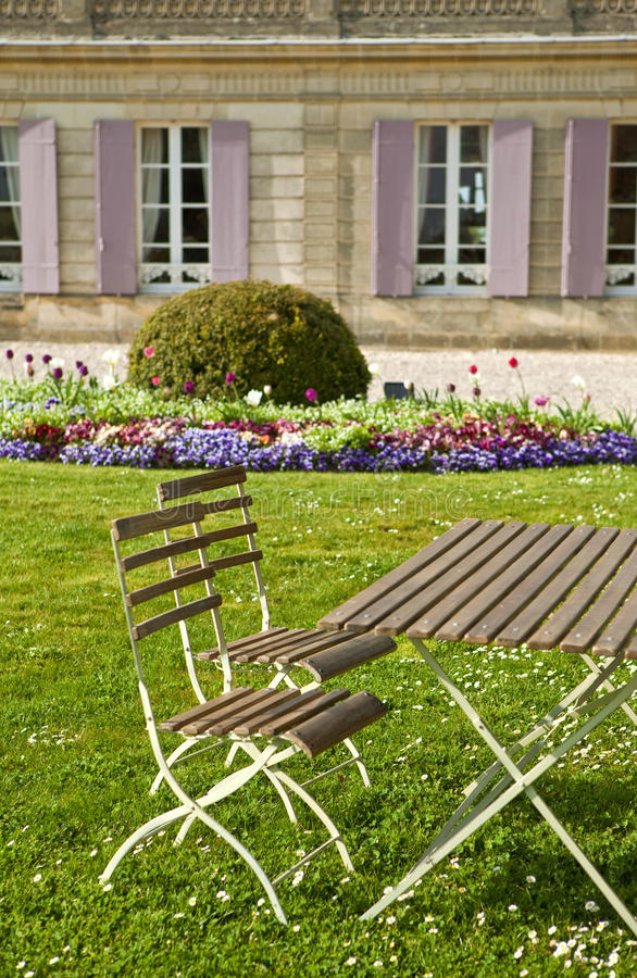 Garden. Furniture in the park of a French mansion stock photography