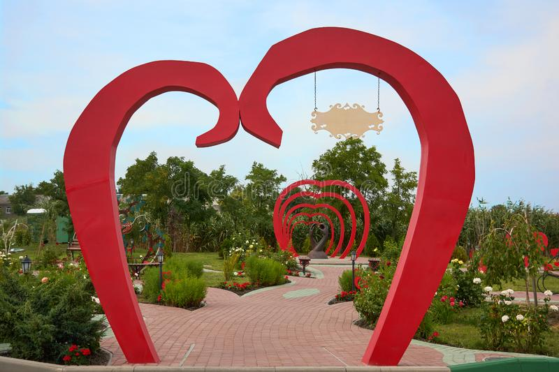 Garden arch in the form of red heart. Installation on the theme of love, weddings in the park of lovers of hearts, Dobroslav, royalty free stock images