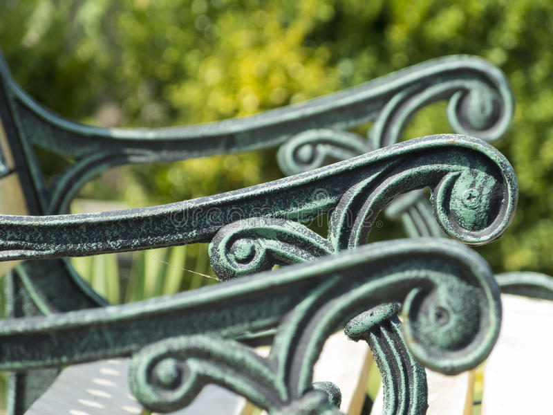 Garden bench with ornaments royalty free stock images