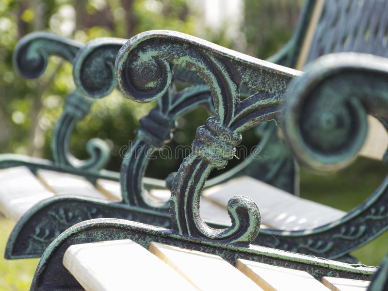 Garden bench with ornaments stock images