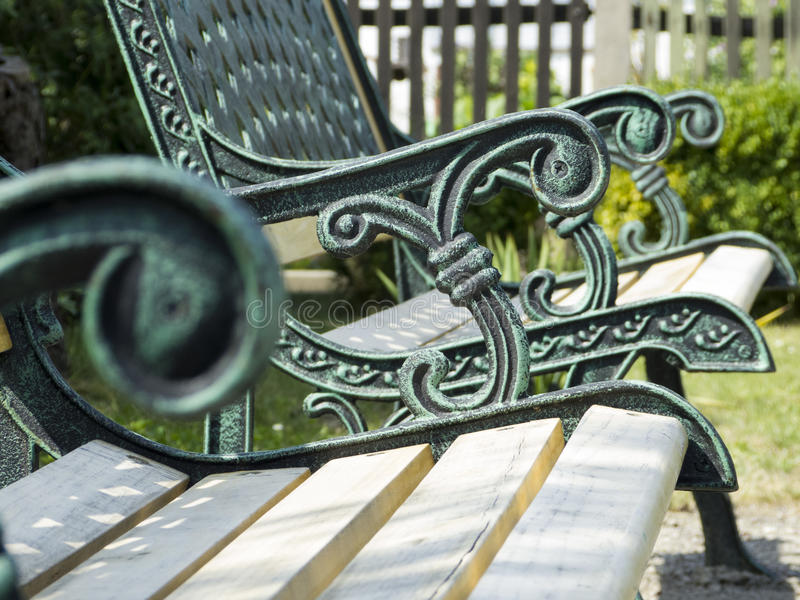 Garden bench with ornaments stock image