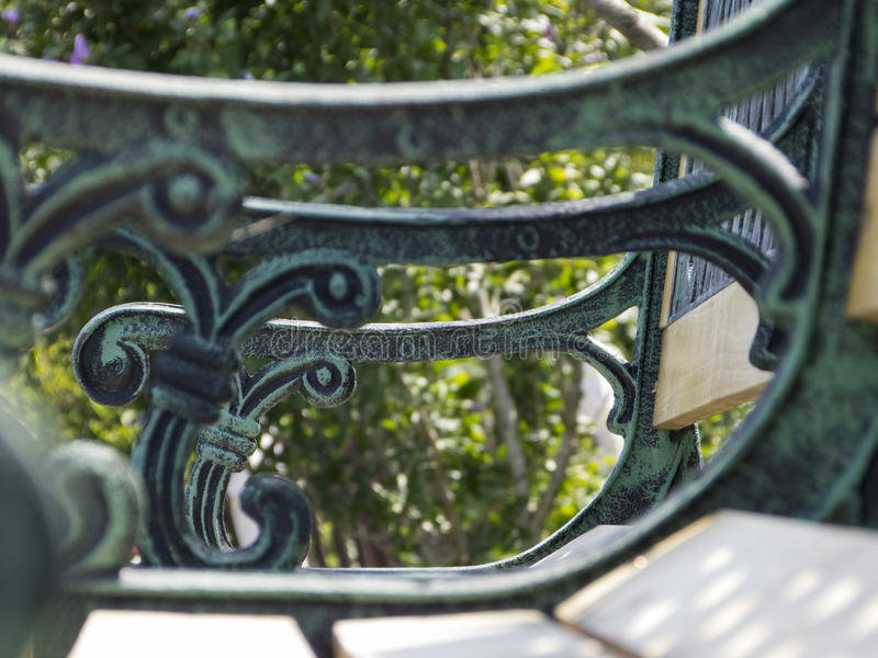 Garden bench with ornaments stock photography