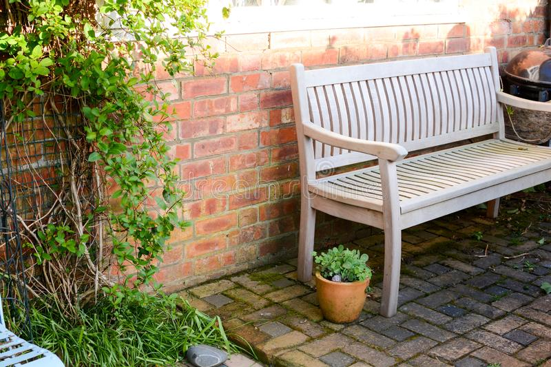 Garden patio. Garden bench and outdoor furniture on a patio royalty free stock photos