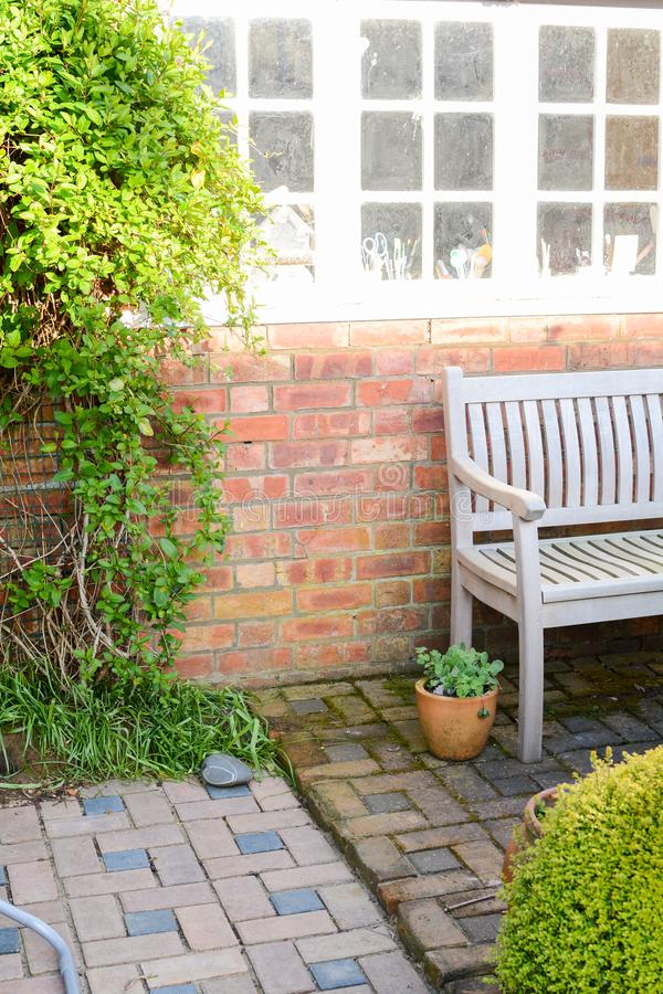 Garden patio. Garden bench and outdoor furniture on a patio stock photos