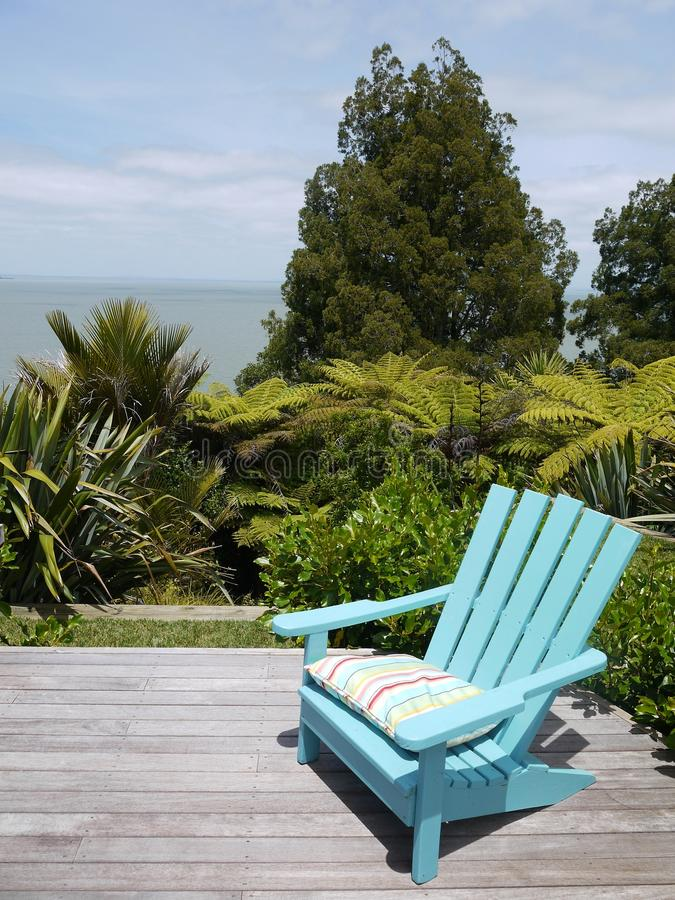 Free Garden: Blue Chair On Wooden Deck Royalty Free Stock Image - 28056886