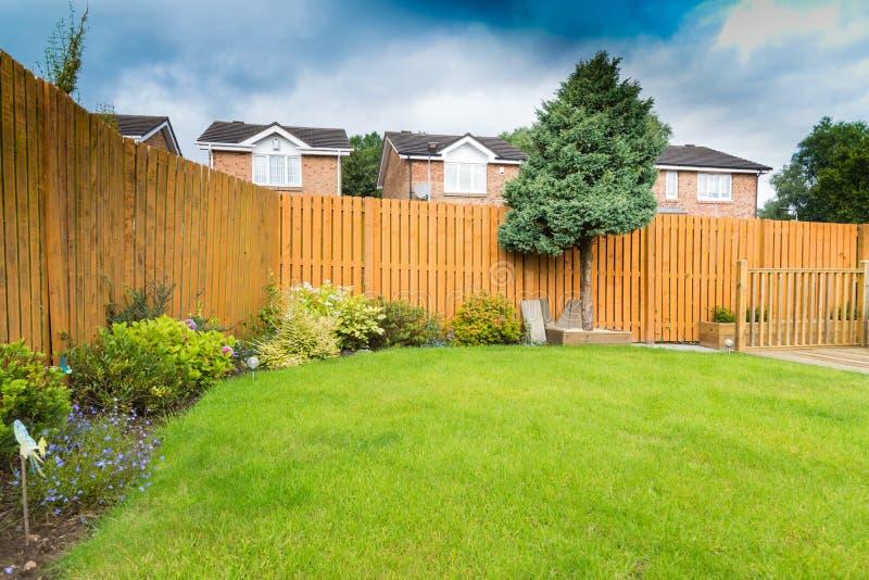 Garden Border with fencing and shrubs stock photos