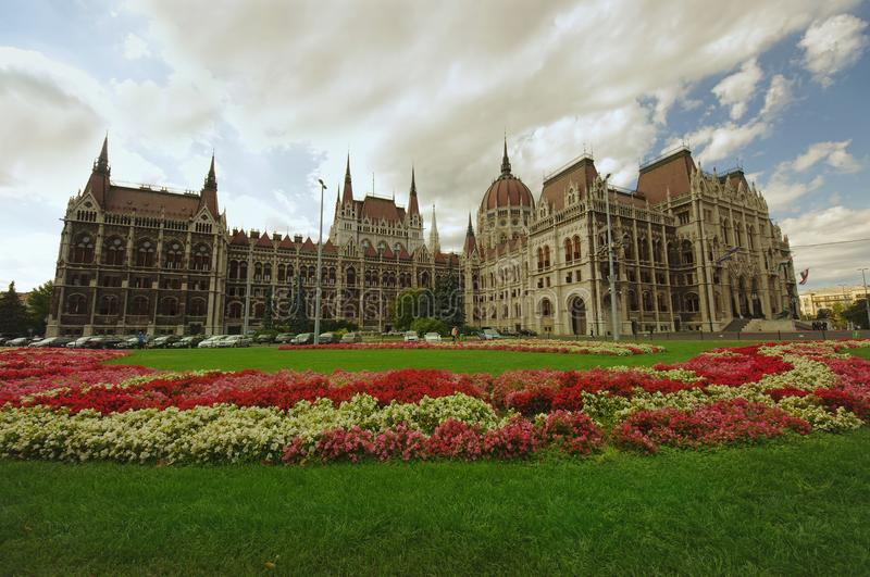 Garden of Budapest city Parliament. Full of flowers. wide view royalty free stock image