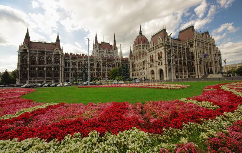 Garden of Budapest city Parliament. Full of flowers. wide view stock images
