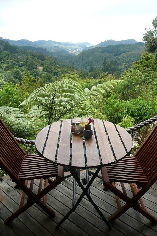 Garden cafe: table with view stock photos