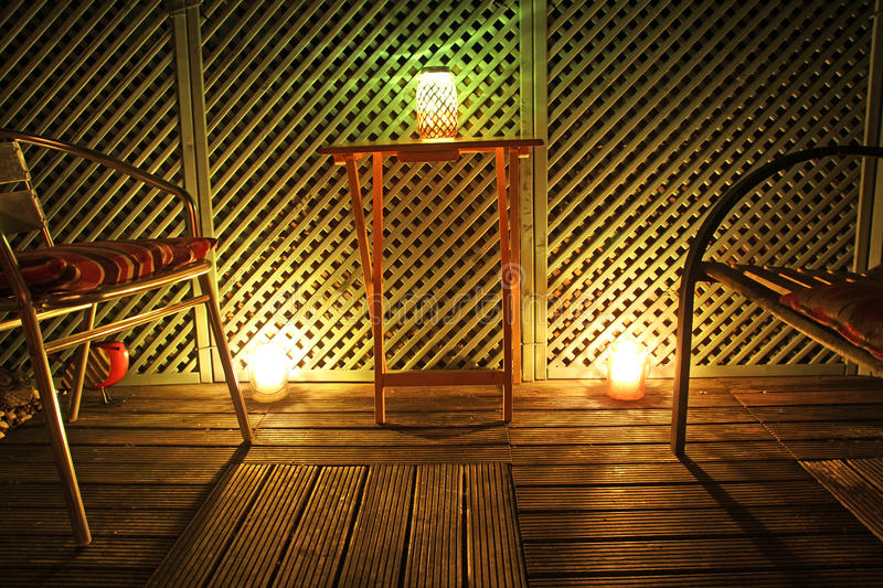 Garden by candlelight. Photo of a garden patio area at night illuminated by candlelight taken 26th may 2017 royalty free stock photography