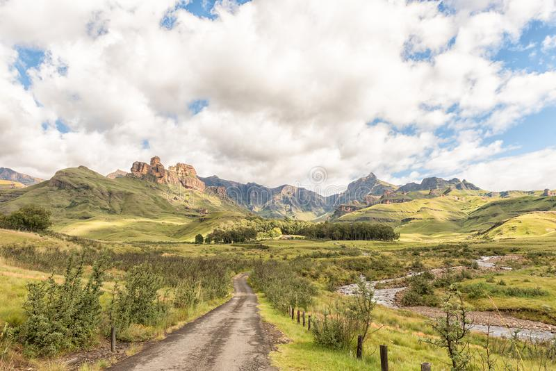 Garden Castle in the Drakensberg near Underberg. Hermits Wood Camp Site is visible between the trees in the back and the Mlambonja River to the right. Rhino stock images