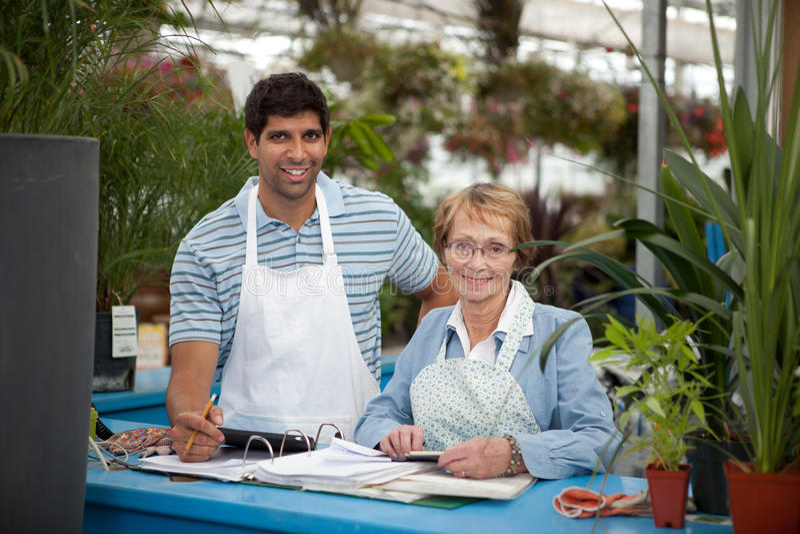 Download Garden Center Employees stock image. Image of gardening - 22213439