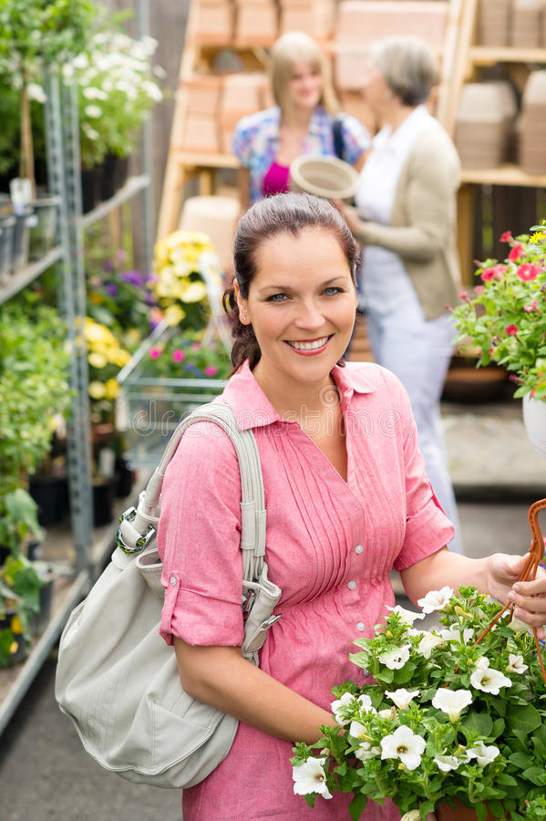 Download Garden Centre Woman Hold White Potted Hibiscus Royalty Free Stock Images - Image: 25727619