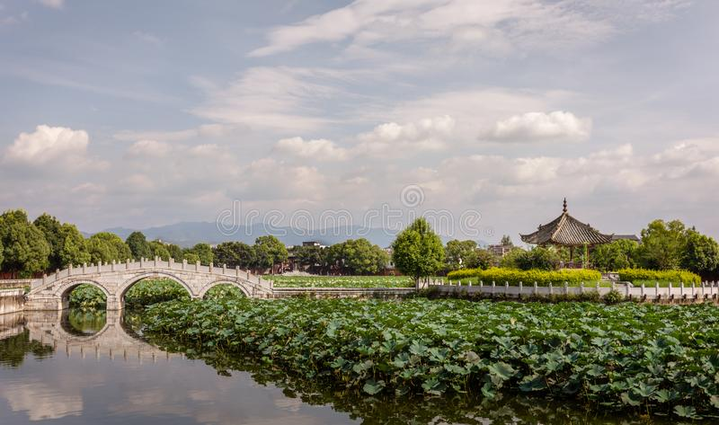 Traditional Chinese garden in the Confucian Temple or Wenmiao, Jianshui, Yunnan, China. Garden in the Confucian Temple or Wenmiao with lotus in the pond and royalty free stock photography