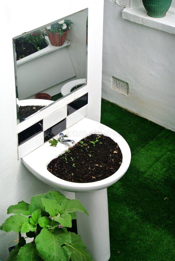 Garden created by recycling bathroom sanitary ware. The garden created by recycling bathroom sanitary ware stock photos