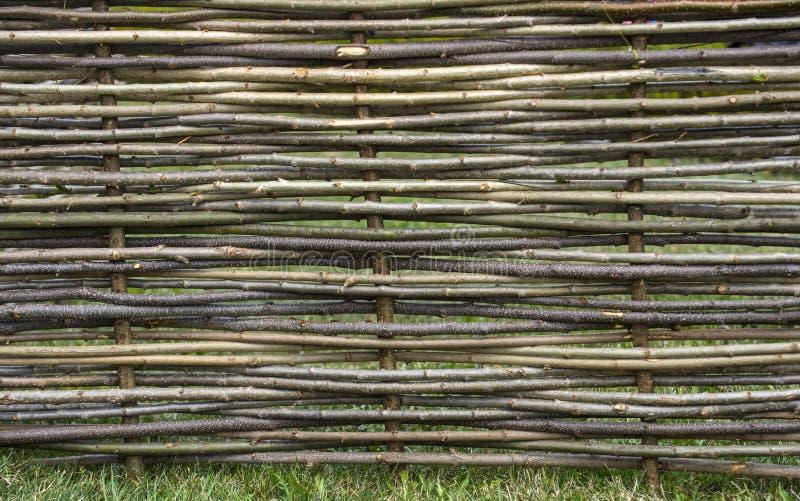 Garden decor, barrier, border, boundary. Fence of wooden twigs. Natural tree trunk texture. Spring summer season stock photos