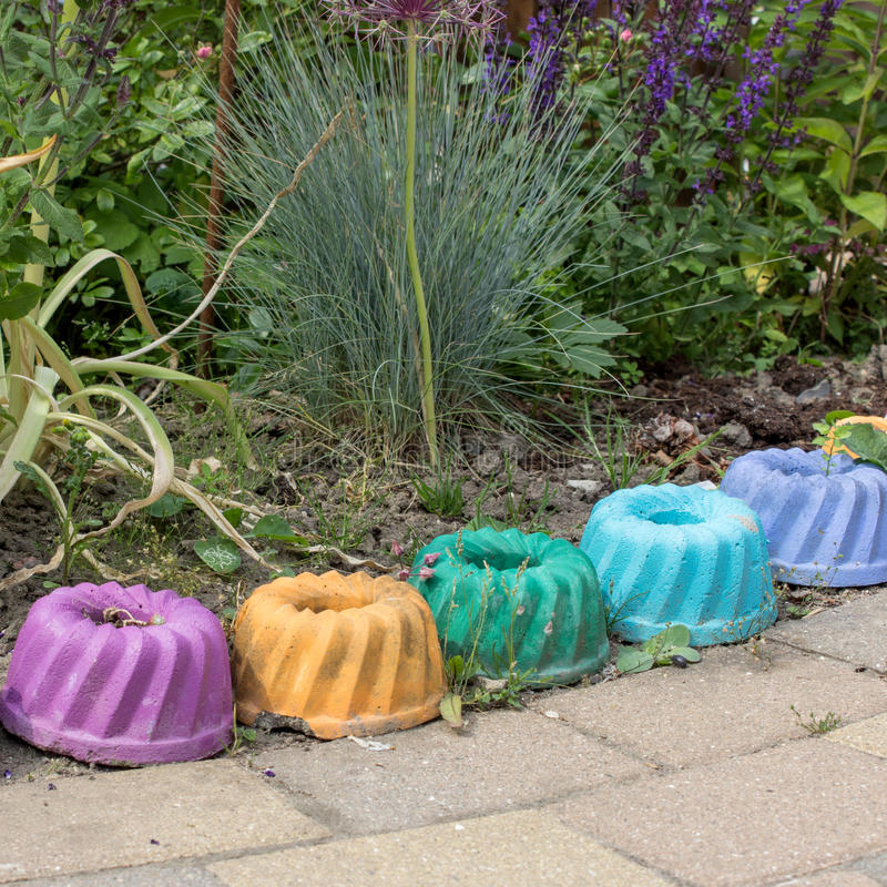 Garden decoration. Perennial with colorful ring cake decoration royalty free stock photo