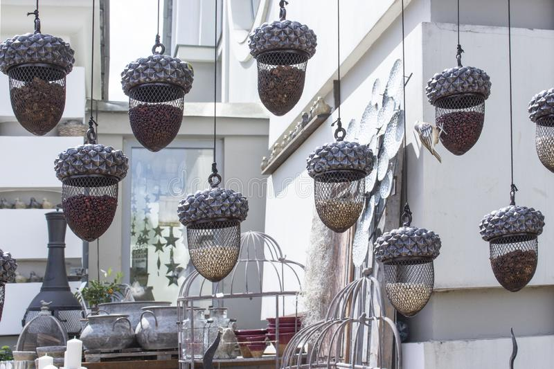 Garden decorations, net vases in the shape of an acorn. Beautiful hanging vases of acorns on the background of a garden shop stock photos