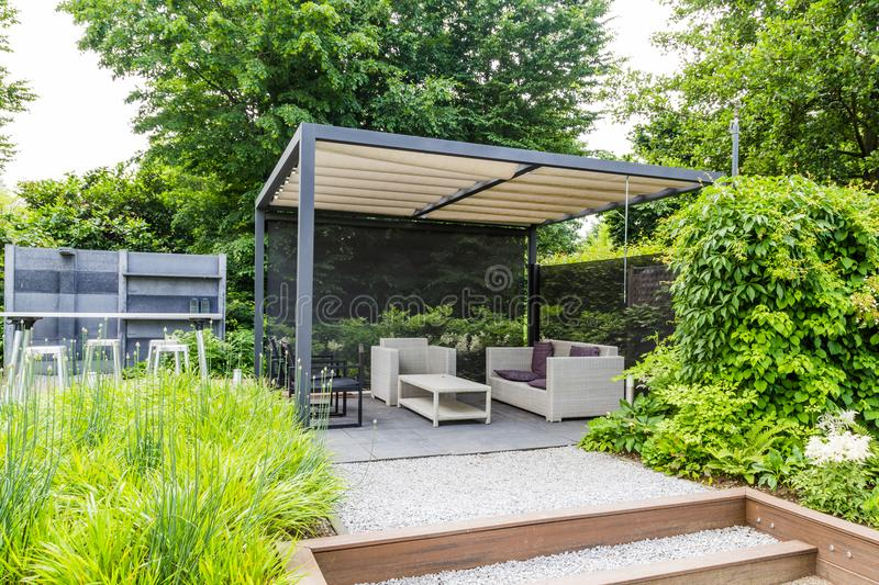 Garden design with metal rooftop and patio. Garden design with grey metal rooftop and patio stock photos