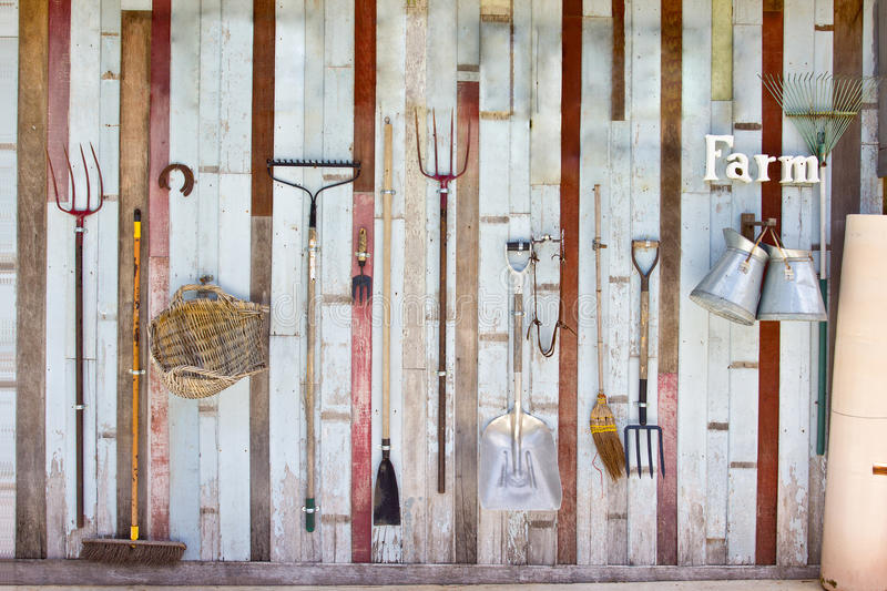 Garden equipment collection. Hand on the wall stock image