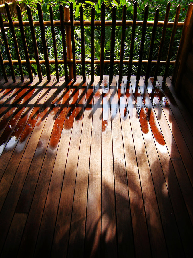 Garden fencing and shadows stock photography