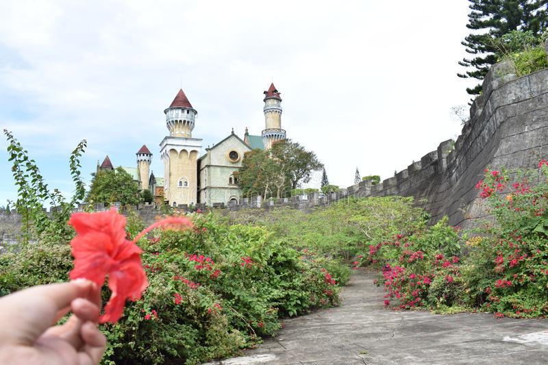 Garden flowers street people crowd road blue sun daylight day high manila Philippines structure travel abandoned castle wall. Buildings streets street people royalty free stock photo