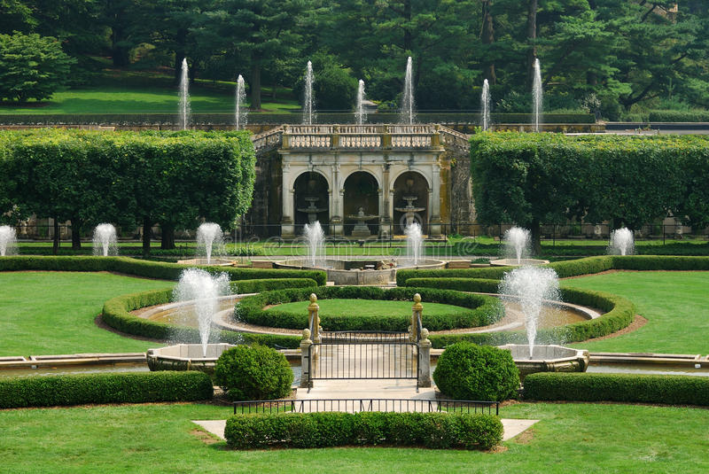 Garden with fountain stock images