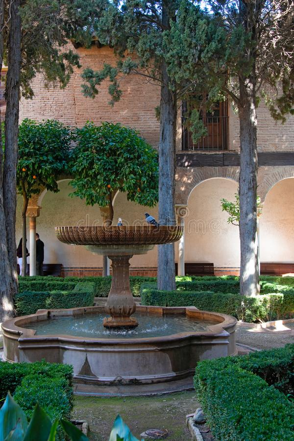 Garden with fountain in the Alhambra in Granada royalty free stock photography