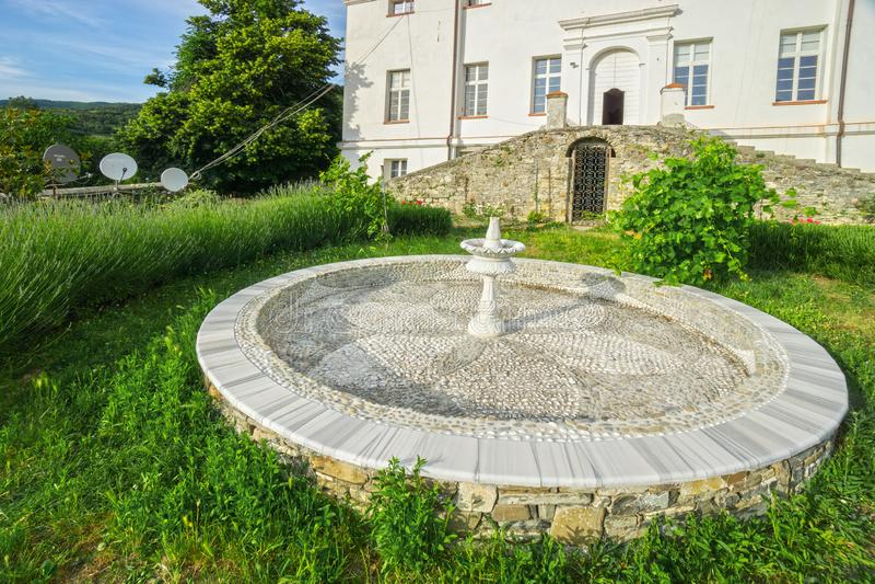 Garden in front of Shri Mataji`s castle in Cabella Ligure. Town during summer,  provincia di Alessandria, Italy, Europe stock photos