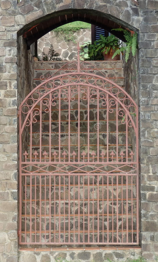 A garden gate at belmont house on bequia. A picture of a gate leading from garden to house on bequia in the caribbean royalty free stock image