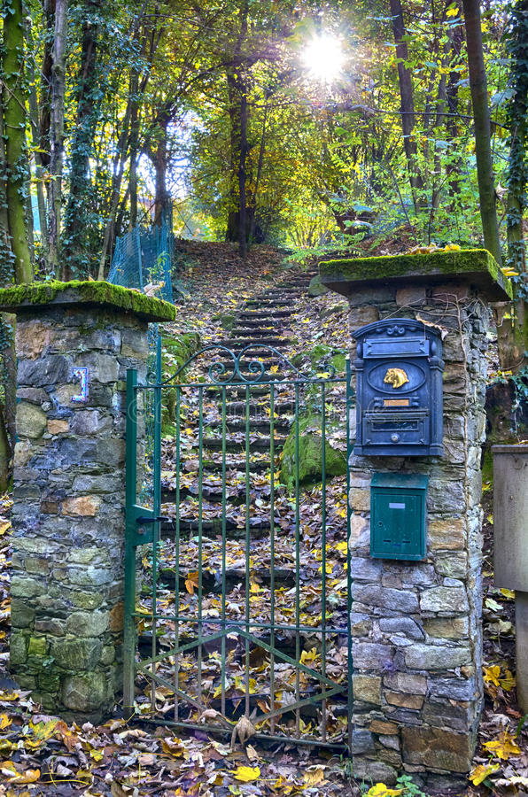 Garden gate and stairs. Romantic garden door and stairs of an Italian house. Sunbeams come through the trees. Stresa, Piedmont,Italy stock photos