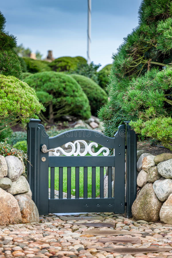 Garden gate. With a stone wall royalty free stock images