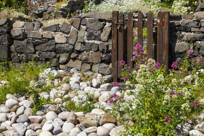 Garden gate in stone wall. royalty free stock image