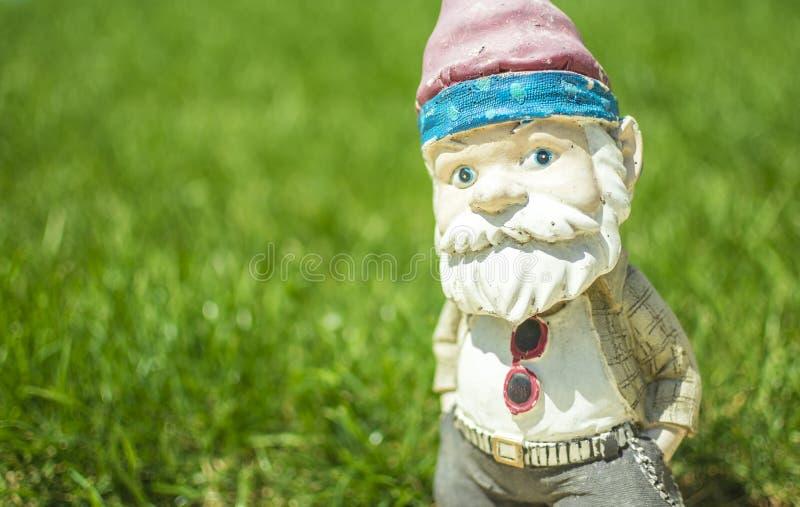 Garden gnome posing stock image