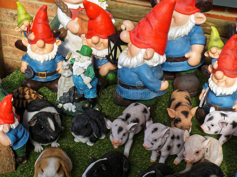 Garden Gnomes and Farm Animals. A collection of garden gnomes and farm animals in a rural-type setting royalty free stock photo