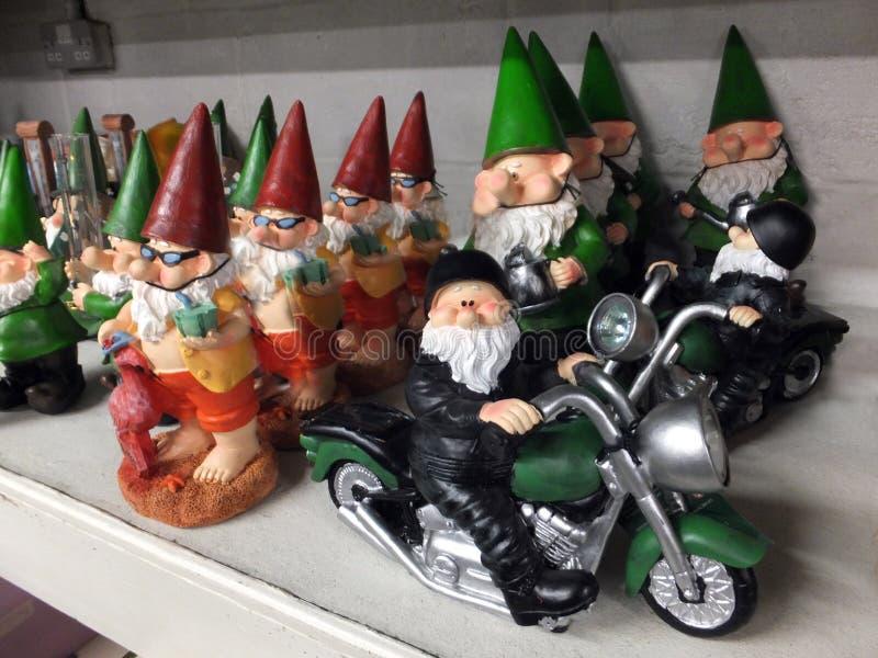Garden Gnomes. A Row of Garden Gnomes on a Shelf royalty free stock photos