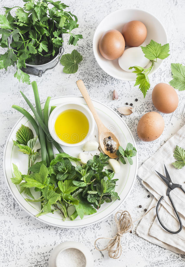 Garden herbs, spices and eggs on a light table. Rustic kitchen still life. Ingredients for cooking. Top view stock photo