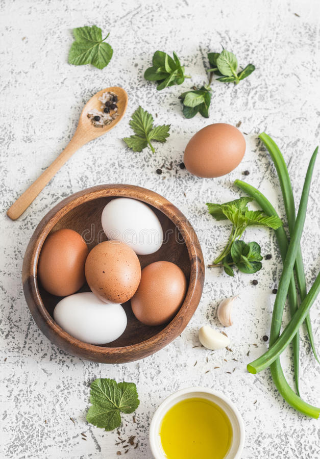 Garden herbs, spices and eggs rustic kitchen still life.On a light table, top view. Flat lay. royalty free stock images