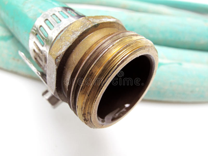 Garden Hose. Closeup view of garden hose with shallow depth of field stock photo