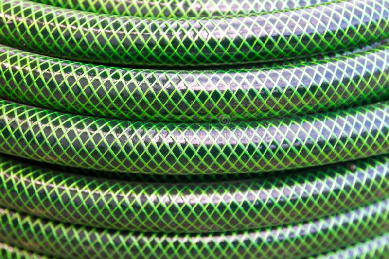 Garden hose pipe green water close up stock photography