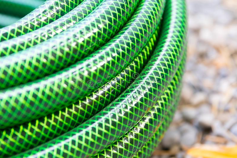 Garden hose pipe green water close up stock image