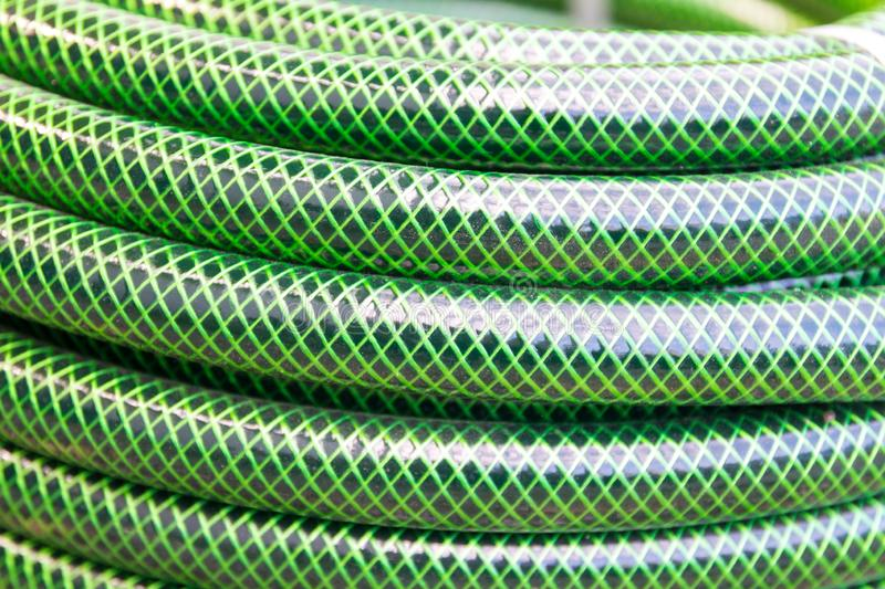 Garden hose pipe green water close up stock images