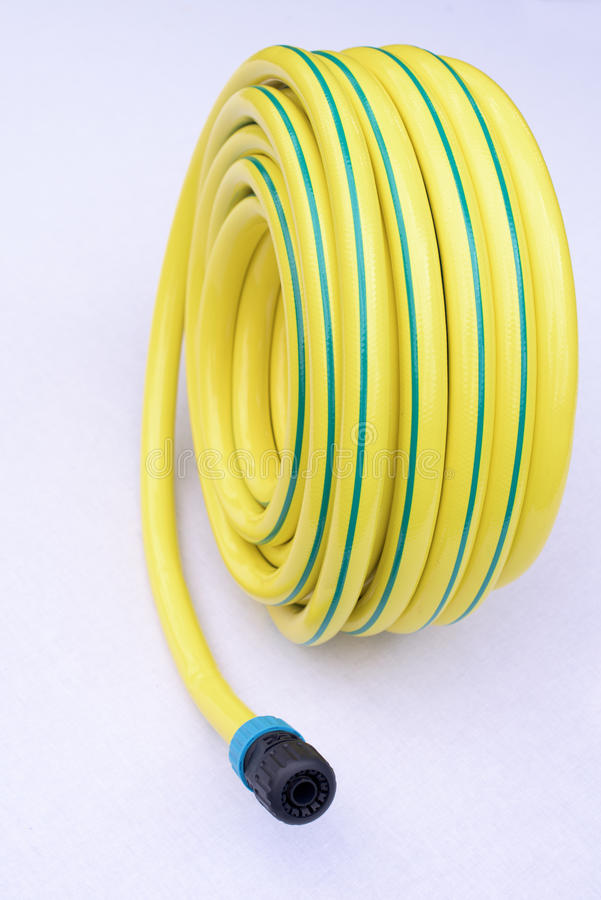 Garden hose-pipe on white stock image