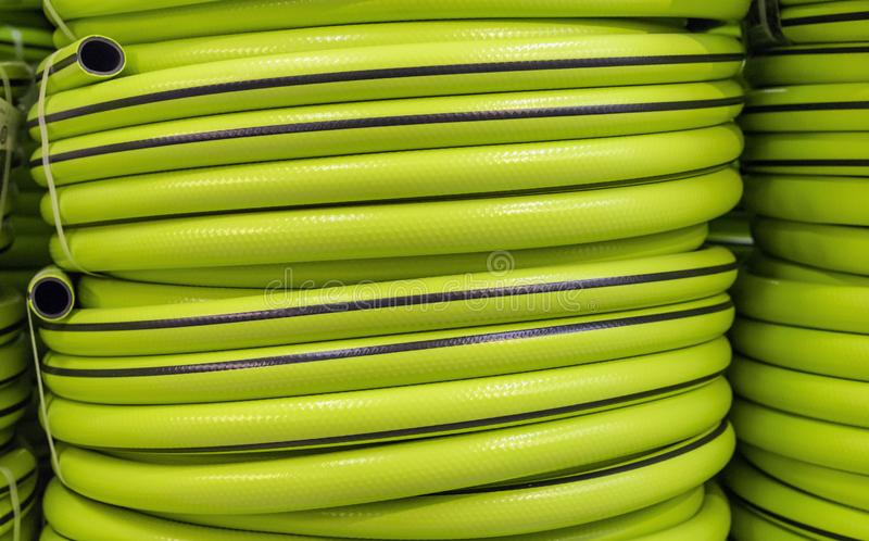 Garden hose in a roll for watering. Garden tools stock image