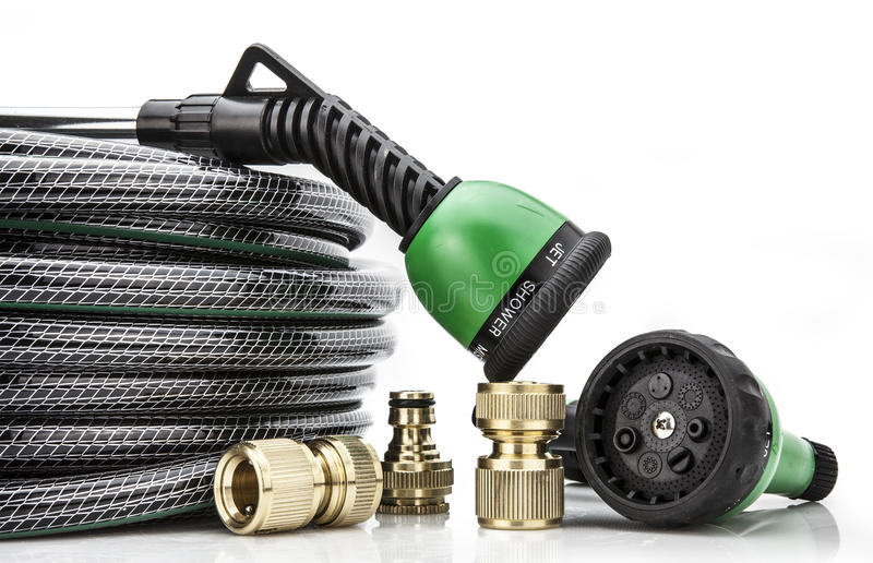 A garden hose with a sprayer royalty free stock photography